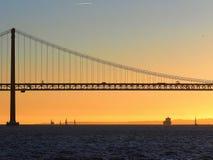 Sunset over 25th april bridge in Lisbon. Sunset over Ponte 25 de Abril bridge in Lisbon in Portugal royalty free stock photography