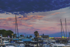 Sunset Over The Harbour And Bars In Golfe Juan Stock Photos