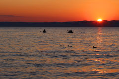 Free Sunset Over The Lake With Boats And Ducks Stock Images - 59488044