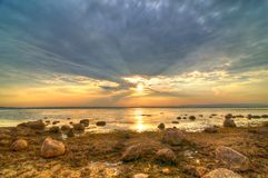 Free Sunset Over The Lake With Many Stones Stock Photos - 30687043