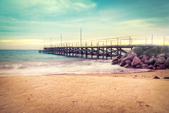 Free Sunset Over The Sea Bridge In Ravda, Bulgaria. Slow Motion Effect. Old Rusty Pier Against The Sunset Rays. Stock Photography - 81068322