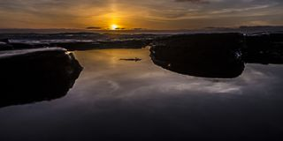 Sunset over tide pools in San Diego California royalty free stock image