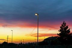 Sunset over town stock photos