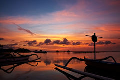 Sunset over traditional fishing boats on Bali Stock Photo