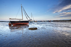 Sunset over the tranquil harbour at Lindisfarne Stock Photography