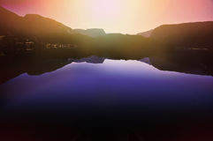 Sunset over tranquil water and mountains Royalty Free Stock Photography