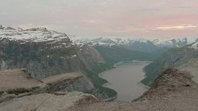Sunset over the Trolltunga. Norway, smooth dolly shot. Sunset over the Trolltunga - Norway, smooth dolly shot stock video