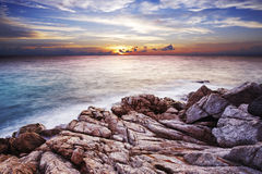 Sunset over the tropical bay. Stock Photos