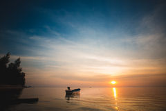 Sunset over the tropical beach Stock Photography