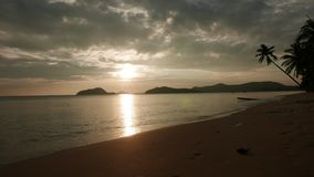 Sunset over tropical beach with winding palm and moody sky. Koh Mak, upgrowing travel destination in Thailand. stock video