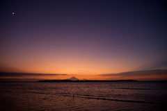 Sunset over tropical island. Sunset in Asia at the island Gili Air in Indonesia Stock Images