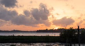 Sunset Over a Tropical Lake Stock Image
