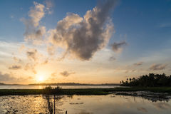 Sunset Over a Tropical Lake Stock Images