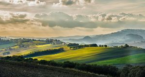 Sunset over a Tuscan valey. In autumn stock image