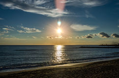 Sunset over the Tyrrhenian Sea on the beach near the port of Rome in Italy Stock Photography