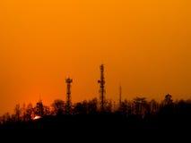 Sunset over urban mountain on orange sky Stock Photo