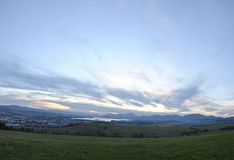 Sunset over the valley surrounded by mountains Royalty Free Stock Image