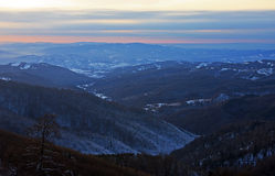 Sunset over the valley. The view from a mountain top of the sunset over the valley bellow Stock Photography