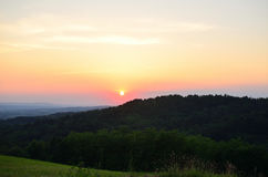 Sunset over valleys Stock Images