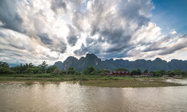 Sunset over Vang Vieng river in Laos Stock Photo