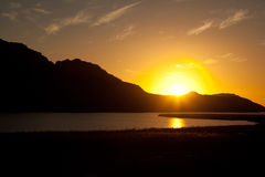 Sunset at Velorenvlei, Elands bay. Sunset over Velorenvlei with the mountain silhouette. Eland Bay Stock Images