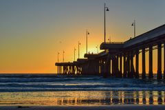 Sunset over Venice Beach Pier in Los Angeles, California royalty free stock photography