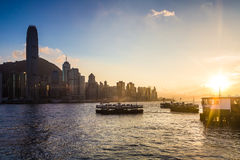 Sunset over Victoria harbor in Hong Kong Royalty Free Stock Photo