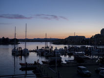 Sunset over the victoria harbor. After the sun has set in Victoria over the harbor Stock Photo
