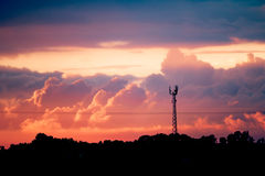 Sunset over the Village signal tower with a silhouettes and dramatic clouds Royalty Free Stock Images