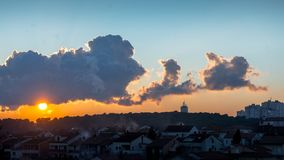 Sunset over village Royalty Free Stock Images