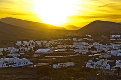Sunset over village of Yaiza Stock Image