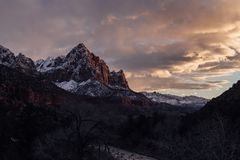 Sunset over The Watchman in Zion National Park. The alpine glow hits the top of The Watchman Tower in Zion National Park, Utah Stock Photo