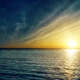Sunset over water. Sunset with clouds over water Royalty Free Stock Images