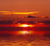 Sunset over water. Reds sunset over water background Royalty Free Stock Images