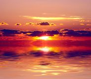 Sunset over water. Photo of red sunset over water Royalty Free Stock Photo