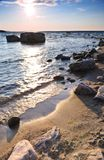 Sunset over water. Sunset at the rocky shore of Georgian Bay, Canada. Awenda provincial park Royalty Free Stock Images