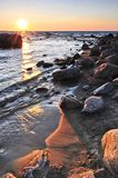 Sunset over water. Sunset at the rocky shore of Georgian Bay, Canada. Awenda provincial park Stock Photo