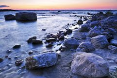 Sunset over water. Sunset at the rocky shore of Georgian Bay, Canada. Awenda provincial park Royalty Free Stock Image