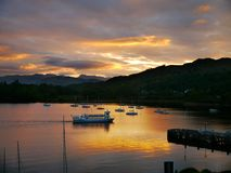 Sunset over water, Ambleside, Lake District, England. Popular visitor destination ambleside at sunset Royalty Free Stock Images