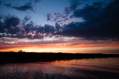 Sunset over water Stock Photography