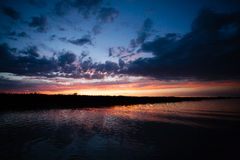 Sunset over water Stock Photos