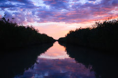 Sunset over water. From `Delta del Po`, Italian landscape. water and sky Stock Images