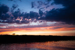 Sunset over water. From `Delta del Po`, Italian landscape. water and sky Stock Photo