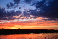 Sunset over water. From `Delta del Po`, Italian landscape. water and sky Royalty Free Stock Image