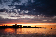 Sunset over water. From `Delta del Po`, Italian landscape. water and sky Royalty Free Stock Photography