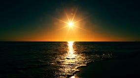 Sunset over water horizon