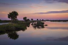Sunset over water - Merritt Island Wildlife Refuge, Florida. Sunset over a saltwater lagoon - Merritt Island Wildlife Refuge, Florida stock image