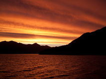 Sunset over water near Queenstown Royalty Free Stock Photos