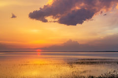 Sunset over water summer evening cloud lake Stock Images