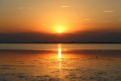 Sunset over the water stock photography